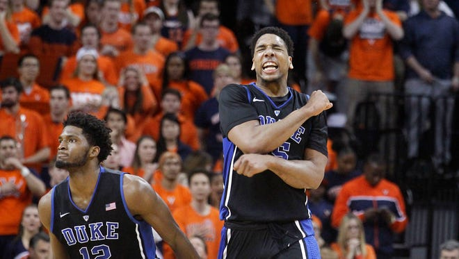 Duke center Jahlil Okafor (15) and forward Justise Winslow (12) celebrate after Duke took the lead in the final minute against Virginia in an NCAA college basketball game in Charlottesville, Va., on Saturday, Jan. 31, 2015. Duke won 69-63.