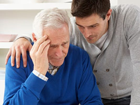 Grown Up Son Consoling Senior Parent