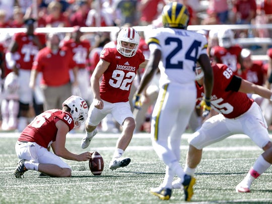 Indiana kicker Griffin Oakes (92) kicks a field goal