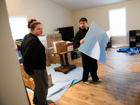 U.S. Army veteran Aaron Hillis and his wife Elizabeth unpack their belongings and begin to move into their new home in Boiling Springs on Tuesday, March 6, 2018. Hillis received the home mortgage-free as part of a program through U.S. Bank and Freedom Alliance.
