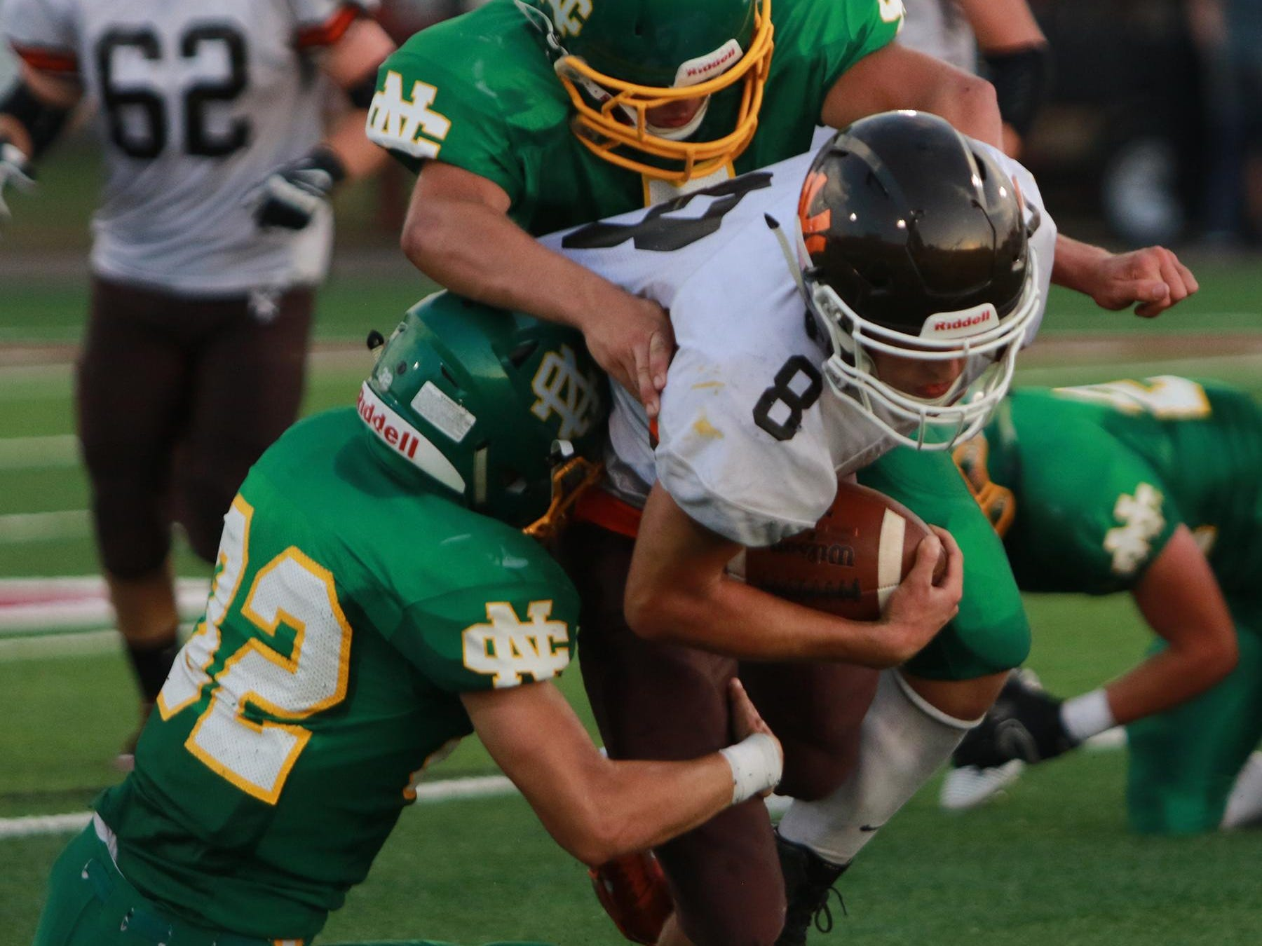 Jud Lewis and Sam Bending tackleHunter Edwards of Nelsonville-York in their first home game of the season.