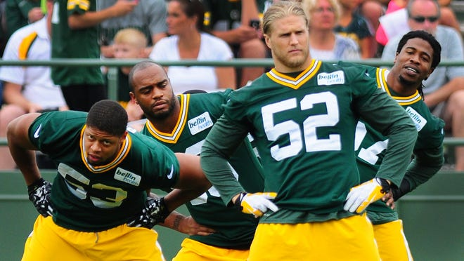 From left, Green Bay Packers linebackers Nick Perry, Mike Neal, Clay Matthews and Jamari Lattimore, warm up during training camp practice at Ray Nitschke Field on Thursday, Aug. 21, 2014.