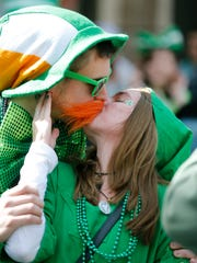 Webster residents Luke Peters and Caitlin Dailey kiss during the St. Patrick's Day Parade in 2016.