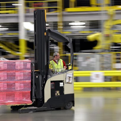 A forklift operator moves a pallet of goods at an Amazon.com fulfillment center in DuPont, Wash. This year, Amazon has been making an aggressive push to offer same-day delivery to its $99 annual Prime loyalty club members.