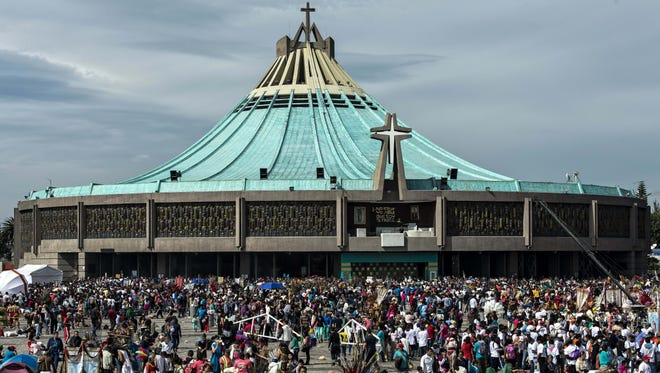 Thousands of pilgrims gather at the Basilica of Our Lady of Guadalupe in Mexico City on December 12, 2015. Catholics commemorate the apparition of the Virgin of Guadalupe in this place to Saint Juan Diego, a native Mexican peasant, in 1531. AFP PHOTO/OMAR TORRES / AFP / OMAR TORRES        (Photo credit should read OMAR TORRES/AFP/Getty Images)