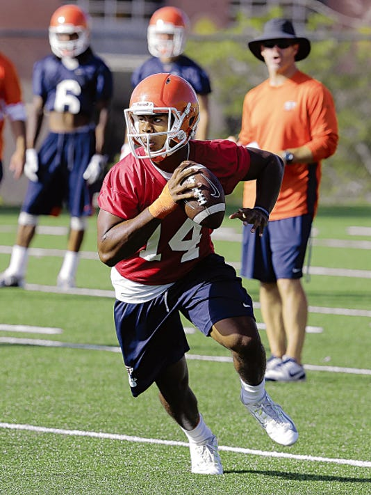 Kavika Johnson, quarterback for the UTEP Miners runs the wildcat during practice Friday morning. Johnson from Las Cruces, N.M. (Mayfield HS) is expected to see  plenty of action this year.