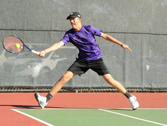Wylie's Davyn Williford reaches for a shot during his No. 2 singles match at the Region I-4A semifinals at Rose Park on Thursday Oct. 26, 2017. Williford's match was still in action when the Bulldogs completed the 10-1 victory against Pampa.