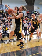 Cascade's Halle Wright comes down with a rebound against