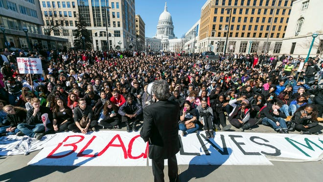 Madison Mayor Paul Soglin addresses a crowd of protesters on Martin Luther King Boulevard in Madison during Monday's protest of the shooting death of Tony Robinson. Madison police officer Matt Kenny shot Robinson on Friday evening while investigating a call that the man was jumping in and out of traffic and had assaulted someone.