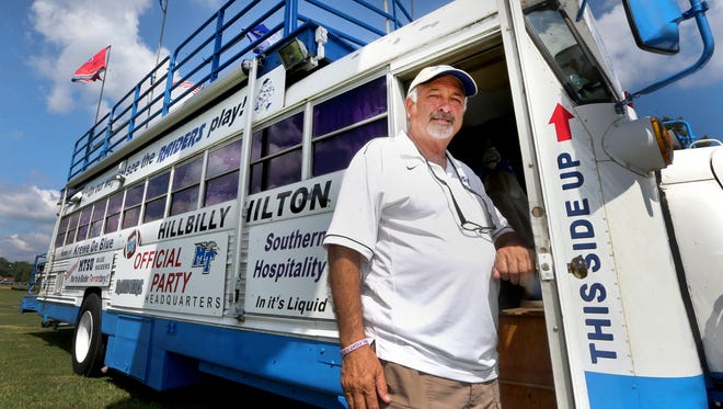 Danny Farrer, the owner of the Hillbilly Hilton, stands with his bus that has been tailgating on for 20 years, on Thursday, Sept. 1, 2016. Farrer and his wife Dawn Farrer are preparing for the MTSU vs. Alabama A&M game Saturday.