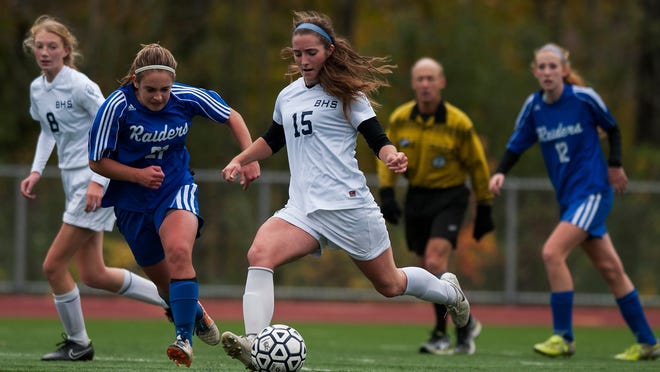 Burlington's Madison Feeney (15) takes a shot during a playoff game against U-32 last fall. Feeney was named the state's Gatorade girls soccer player of the year on Thursday.