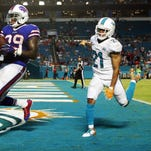 Former Seminole running back Karlos Williams scored his third rushing touchdown of the season against the Miami Dolphins.
