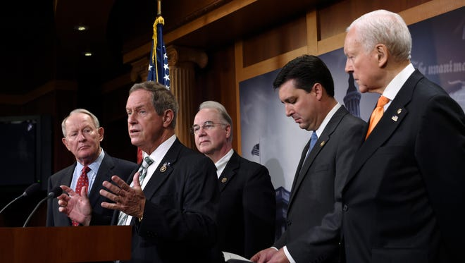 Rep. Joe Wilson, R-S.C. (second from left) talks to reporters on Capitol Hill in Washington on July 27, 2015.