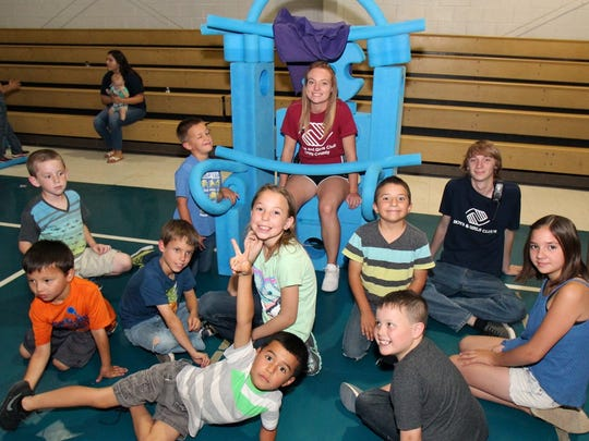 Boys and Girls Club of Otero County members enjoy thier new playground equipment Friday.