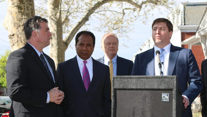 Delaware Sen. Bryan Townsend, a Newark Democrat, speaks at a press conference announcing land bank legislation on Monday. With him, from left, are Rep. Bryon Short, D-Highland Woods, Wilmington Mayor Dennis P. Williams, and Sen. Robert Marshall, D-Wilmington.