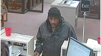 Clinton Township police are searching for a man who robbed a Fifth Third Bank branch Saturday morning, DEc. 20, 2014. The robbery occurred at about 9 a.m. at the bank branch at 34564 Harper in Clinton Township, according to a news release from police. The suspect, who ran off, was described as a male around 45 to 55 years old who was seen wearing a black jacket and a black winter type hat, police said.