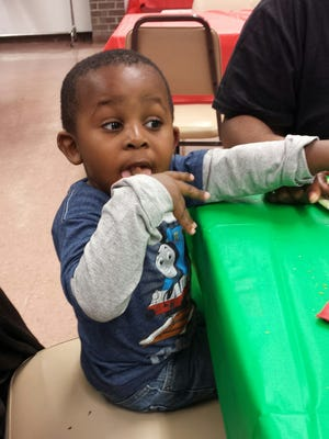 One of Beacon Housing Authority's younger residents enjoys a previous Holiday Party.