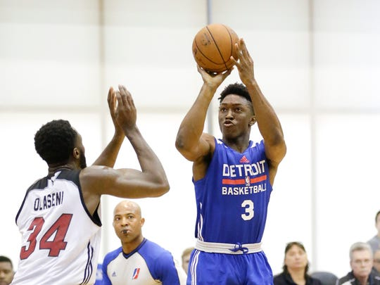Detroit Pistons' Stanley Johnson (3) shoots over Miami Heat's Gabriel Olasseri during the first half of an NBA summer league basketball game, Friday, July 10, 2015, in Orlando, Fla.