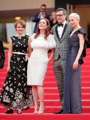 Actresses Millicent Simmonds, left, Julianne Moore,  Michelle Williams and screenwriter Brian Selznic leave the 'Wonderstruck' screening during the 70th annual Cannes Film Festival.