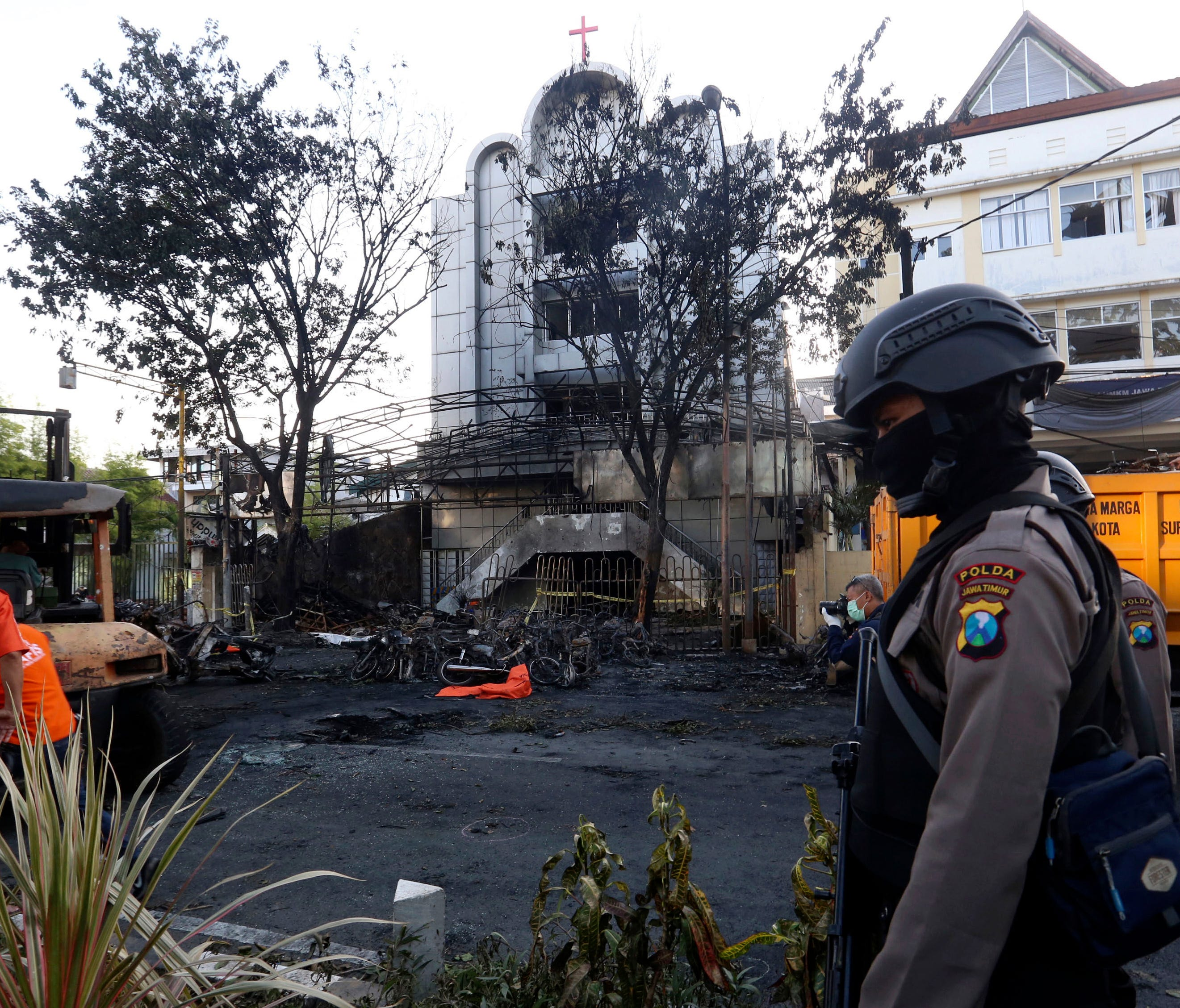 A police officer stands guard at one of the sites of church attacks in Surabaya, East Java, Indonesia, on May 13, 2018.