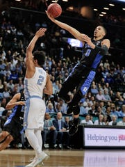 Duke forward Jayson Tatum (0) goes up for a shot against North Carolina guard Joel Berry II (2) in the first half of an NCAA college basketball game during the semifinals of the Atlantic Coast Conference tournament, Friday, March 10, 2017, in New York. (AP Photo/Julie Jacobson)