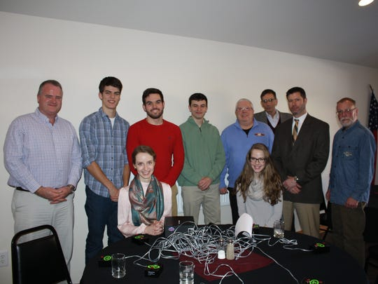 Sayre Rotary scrimmages with Sayre High School students in preparation for their appearance at Scholarship Challenge. Pictured, from left, are: Larry Templeton, Marcos Velazquez, Amanda Mooney (seated), Alex Felt, Nicholas Sweet, Scholarship Challenge founder Chuck Carver, Stacey Mooney (seated), Dick Friend, Dayton Handrick, and Ed Brittain.
