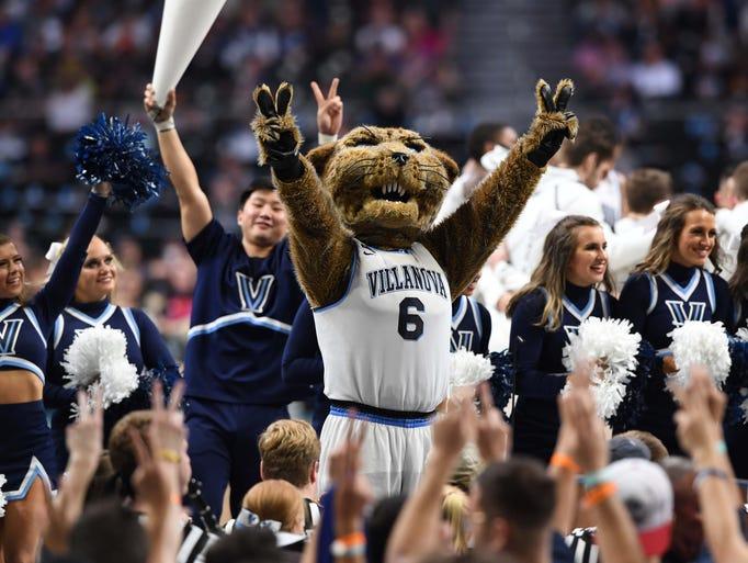 Villanova Wildcats cheerleaders and the mascot perform