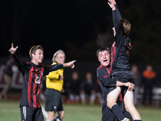 Members of Bennett's celebrate after scoring a goal