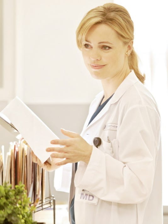 "Melissa George as Dr. Alex Panttiere in a scene from NBC's new drama series ""Heartbreaker."""