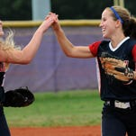 Cocoa Beach palyers Megan Kugelmann (left) and Keri Allen celebrate Friday's district championship victory over Astronaut.