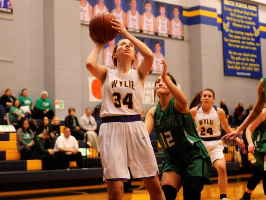Wylie guard Julia Lovelace (34) shoots around Iowa