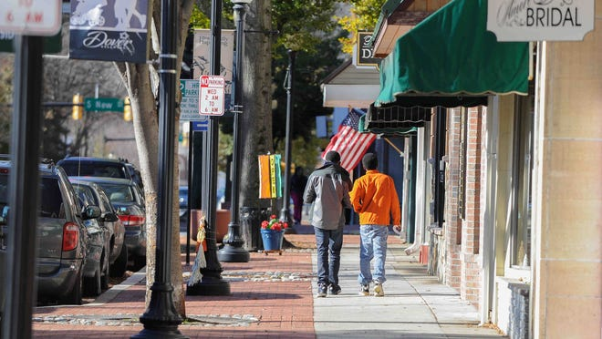 Pedestrians walk in downtown Dover in 2014. A state program is providing grant money, tax credits and other incentives to developers.