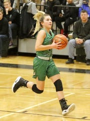 Hanna Strawn goes in for a layup against Elmira in
