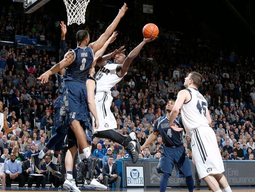 Butler Bulldogs forward Khyle Marshall goes up for a shot against Georgetown Hoyas forward Mikael Hopkins at Hinkle Fieldhouse.