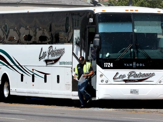 Rudy GutierrezÑEl Paso Times An El Paso police officer exits a Los Paisanos bus along I-10 East just East of downtown El Paso Monday. An incident involving the bus and at least one other vehicle had police completely cose off I-10 East for some time.