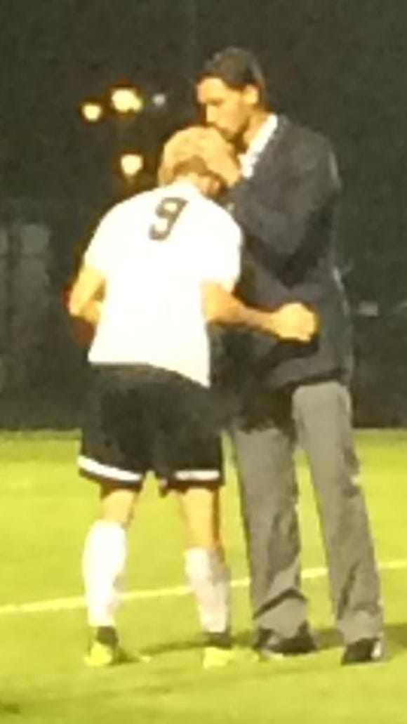 ACA coach Diego da Silva consoles William Showmaker