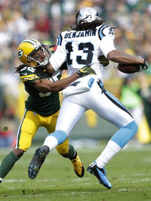 Green Bay Packers cornerback Tramon Williams tackles Carolina Panthers wide receiver Kelvin Benjamin in the second quarter.  The Green Bay Packers host the Carolina Panthers Sunday, October 19, 2014, at Lambeau Field in Green Bay, Wis.  Wm. Glasheen/Post-Crescent Media