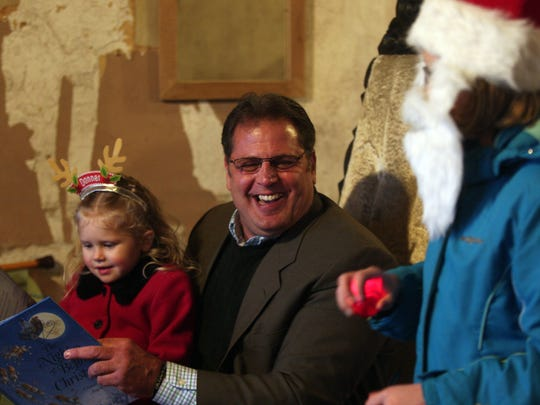 Mayor Michael Dachisen and helper 4-year-old Johannah Churchill of Rockaway during an audience-participative 'Twas the Night Before Christmas' reading at the 16th Annual Historic Victorian Christmas.  
