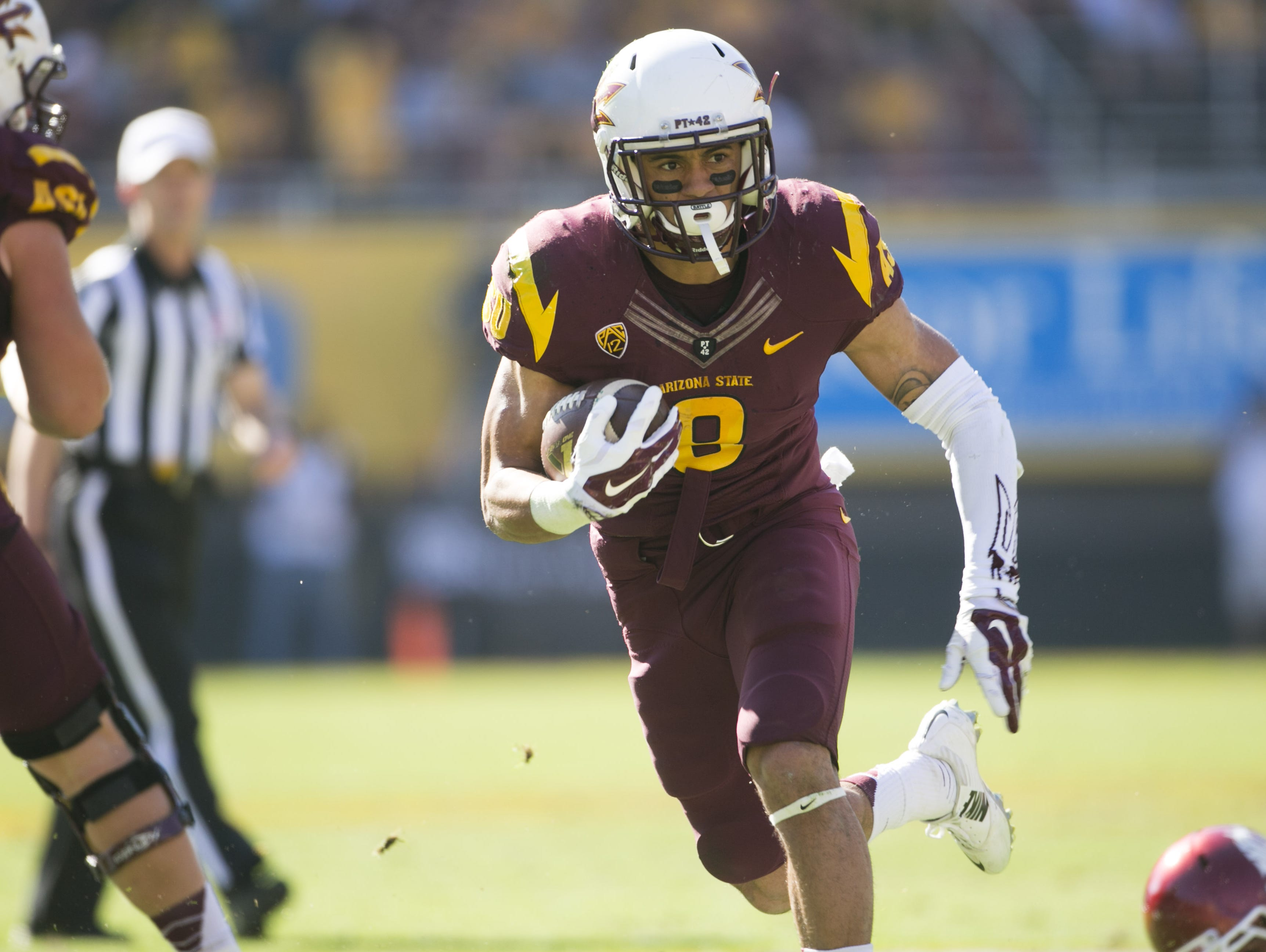ASU running back D.J. Foster carries the ball for a touchdown against Washington State during the first half of the PAC-12 college football game at Sun Devil Stadium in Tempe on Saturday, November 22, 2014.