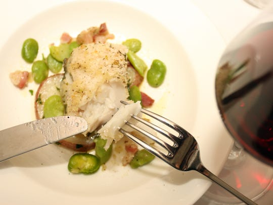 Herb-crusted codfish served with Ceraiola-style red potatoes and fava beans in pancetta sauce photographed at Al Dente Ristorante in the Hyatt Regency Guam on Aug. 17.