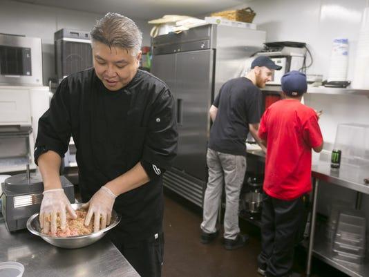 Chef Bob Tam prepares the dumpling burger