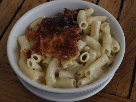 Zingerman's Roadhouse in Ann Arbor offers a half-dozen kinds of mac and cheese, including its classic Roadhouse made with pan-caramelized 2-year-old Cabot cheddar and imported Italian pasta.