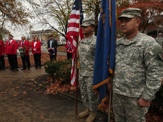 The 3rd Battalion, 112th Field Artillery color guard PFC. Junel Nunez, l, and PFC. John Michael Elefante during the Memorial and Veterans Day Association of Morristown and Morris Twp's Veteran's Day ceremonies on the Morristown Green. November 11, 2015, Morristown, NJ.