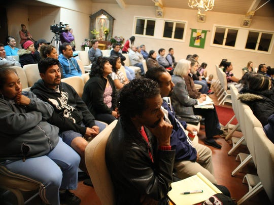 Members of the community listen as Monterey County