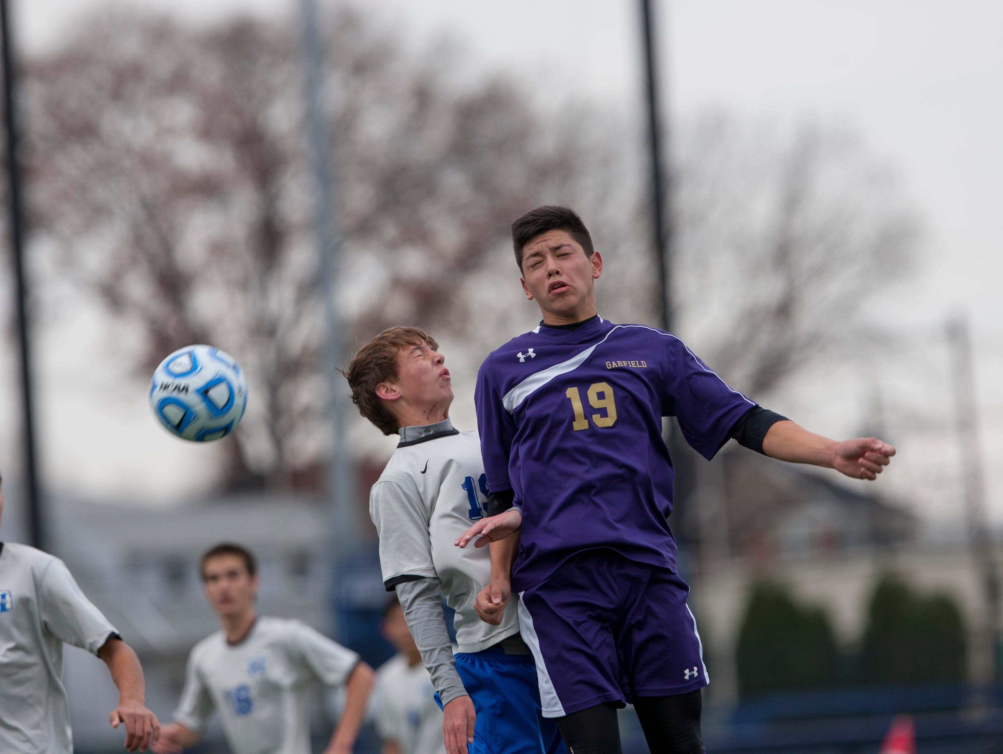 Holmdel's Justin McStay and Garfield's Mahmoud Qatmira battle for a headball during first half action. Holmdel Boys Soccer vs Garfield in NJSIAA State Group II Championship at Kean University on November 22, 2015 in Union, NJ.