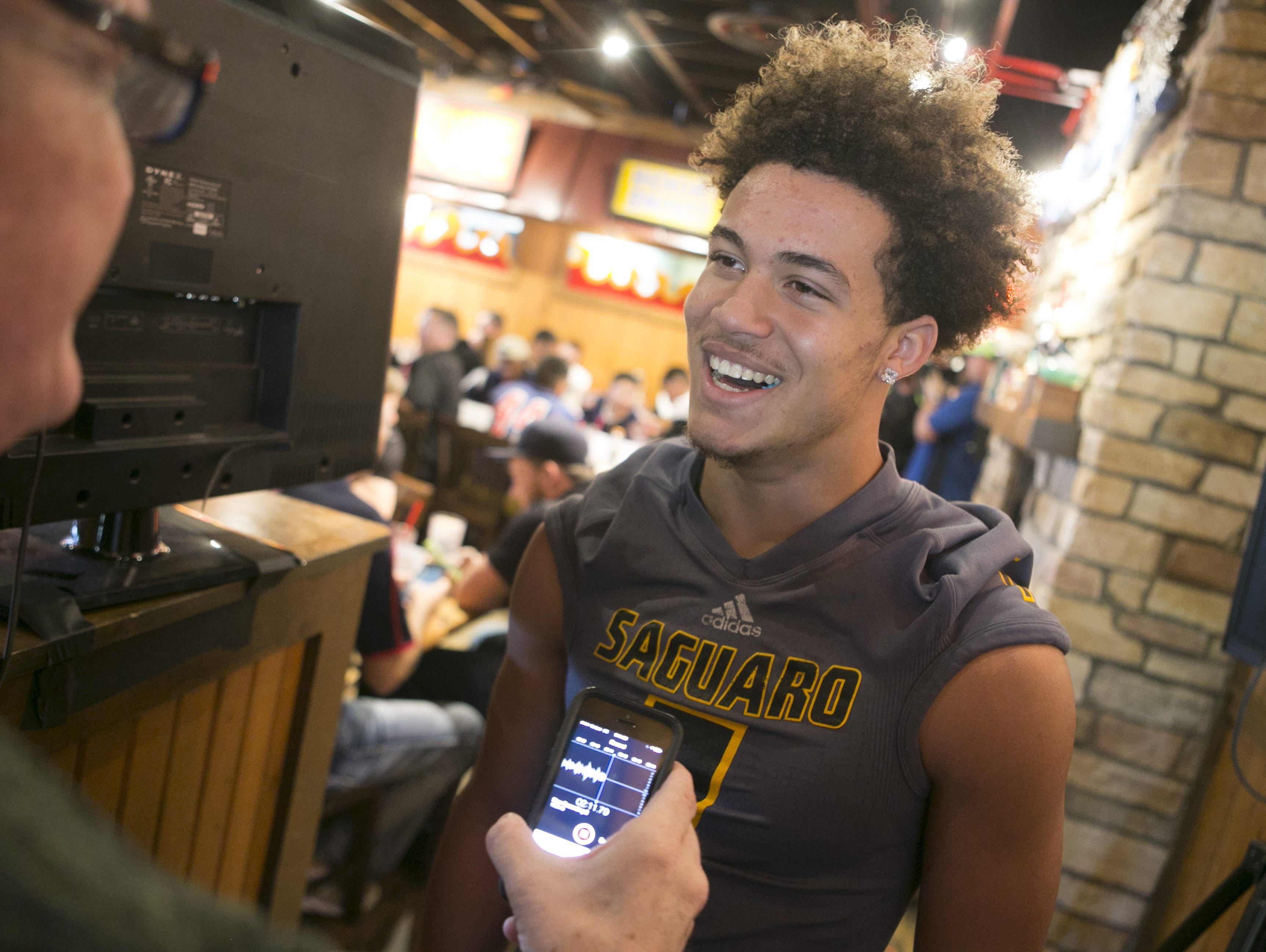 Saguaro High defensive back and wide receiver Byron Murphy smiles while being interviewed during the AIA high school football championship media day at Famous Dave's Bar-B-Que in Mesa on Tuesday, November 24, 2015.