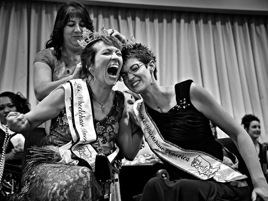 The new Ms. Wheelchair America, Dr. Alette Coble-Temple, left of California, celebrates with the outgoing Ms. Wheelchair America Samantha Schroth after Coble-Temple was named 2016 Ms. Wheelchair America at the Marriott in Downtown Des Moines on Aug. 1, 2015.