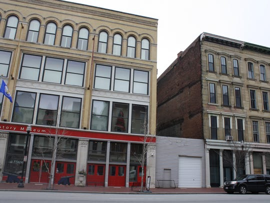 The Frazier History Museum, left, is next to remains