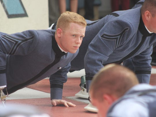 Cameron Massengale does push-ups during parents weekend