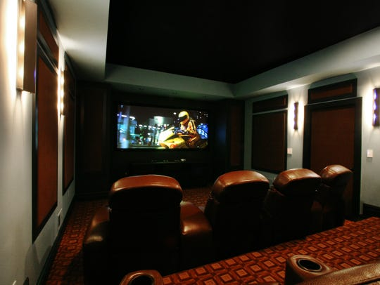A custom designed home theater by Home Theater Group.
